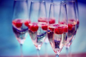 framboisine 1 300x200 - Champagne glasses with raspberry. Summer pool party