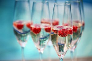 framboisine 300x200 - Champagne glasses with raspberry. Summer pool party